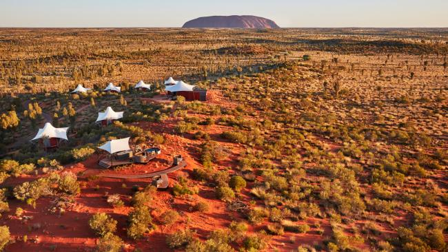 41/41 Where to glamp at Uluru? Ayers Rock Resort's Longitude 131- Yulara, NT Another luxury offering is the Longitude 131 lodge. It's the only hotel that has a view of the rock from the glamping tents, making a stay at this all-inclusive resort a magical experience. You'll be staying in plush tents, with amenities like a free minibar, Aboriginal artworks, a private balcony with a daybed, and - perhaps most importantly - giant windows from which to view Uluru itself. Picture: George Apostolidis See also: - 12 desert experiences to have