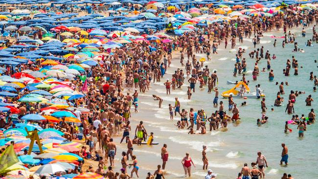 Crowds swamp Levante Beach in the Spanish city of Benidorm in July 2015 as more people head to Spain rather than terrorism-affected destinations such as Tunisia and Turkey. Picture: David Ramos/Getty Images