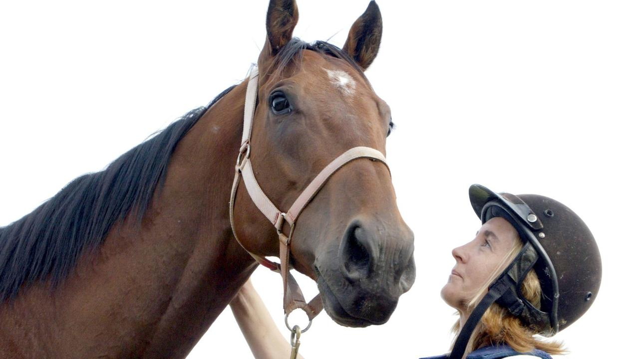 Trainer Danielle Chapman with Snappy Tom on her Woodend property.