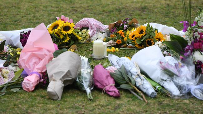 Flowers at a growing makeshift memorial for Eurydice Dixon at the Princes Park sporting precinct, Melbourne, Friday, June 15, 2018. Picture: AAP /Julian Smith.