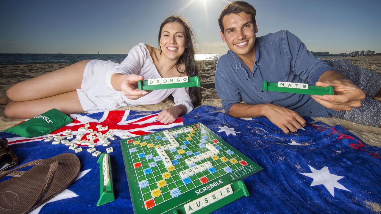 Mattel's Aussie Scrabble uses lots of Aussie lingo. Clarissa Blaufelder, 24, and Dominic Titus, 25, play a game. Picture: Mark Stewart