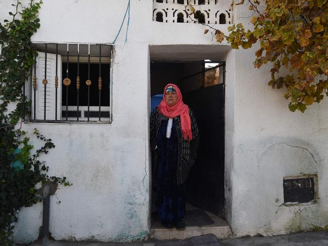 Nour-Houda Amri, the mother of Anis Amri, is seen in front of her house in the town of Oueslatia, in Tunisia's region of Kairouan. Picture: AFP PHOTO / FETHI BELAID