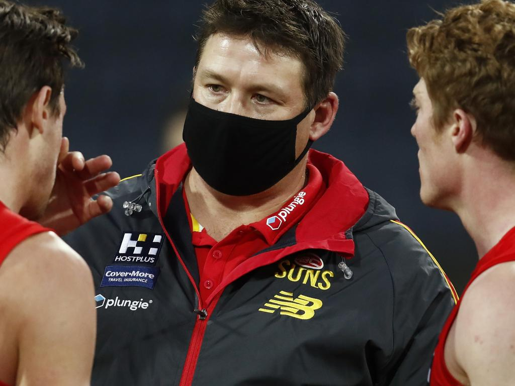 GEELONG, AUSTRALIA - AUGUST 15: Stuart Dew, senior coach of the Suns speaks to David Swallow and Matt Rowell of the Suns during the round 22 AFL match between Gold Coast Suns and Essendon Bombers at GMHBA Stadium on August 15, 2021 in Geelong, Australia. (Photo by Darrian Traynor/AFL Photos/via Getty Images)
