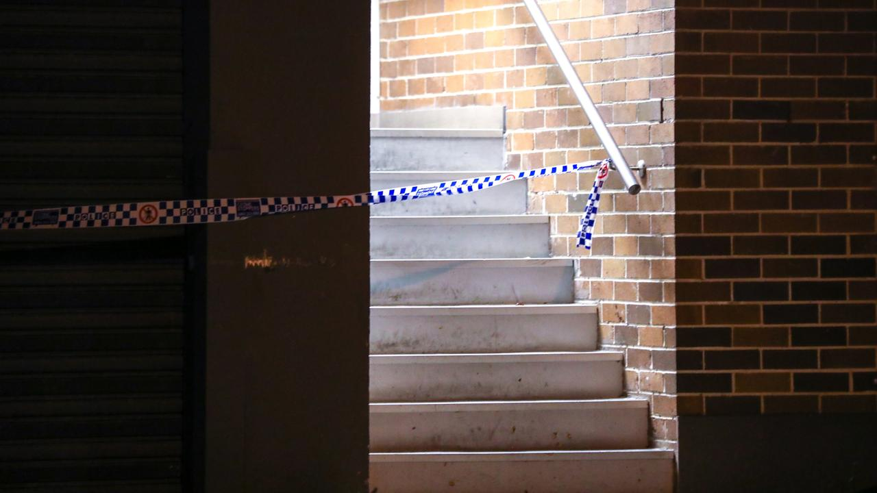 A man is in custody after allegedly throwing a woman from a balcony. He was taken to Redfern Police Station where he is assisting with inquires. Picture: Dean Asher/TNV.