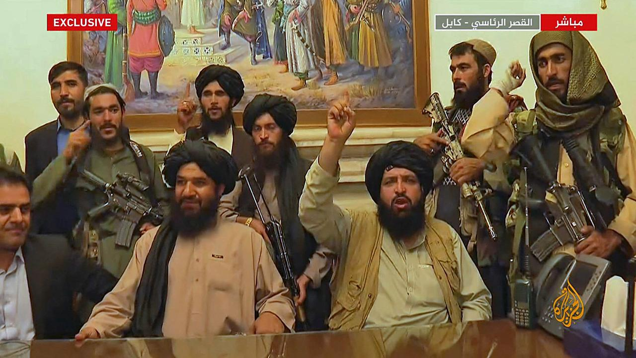 An image grab taken from Qatar-based Al-Jazeera television shows members of the Taliban taking control of the presidential palace in Kabul. Picture: Al Jazeera/AFP