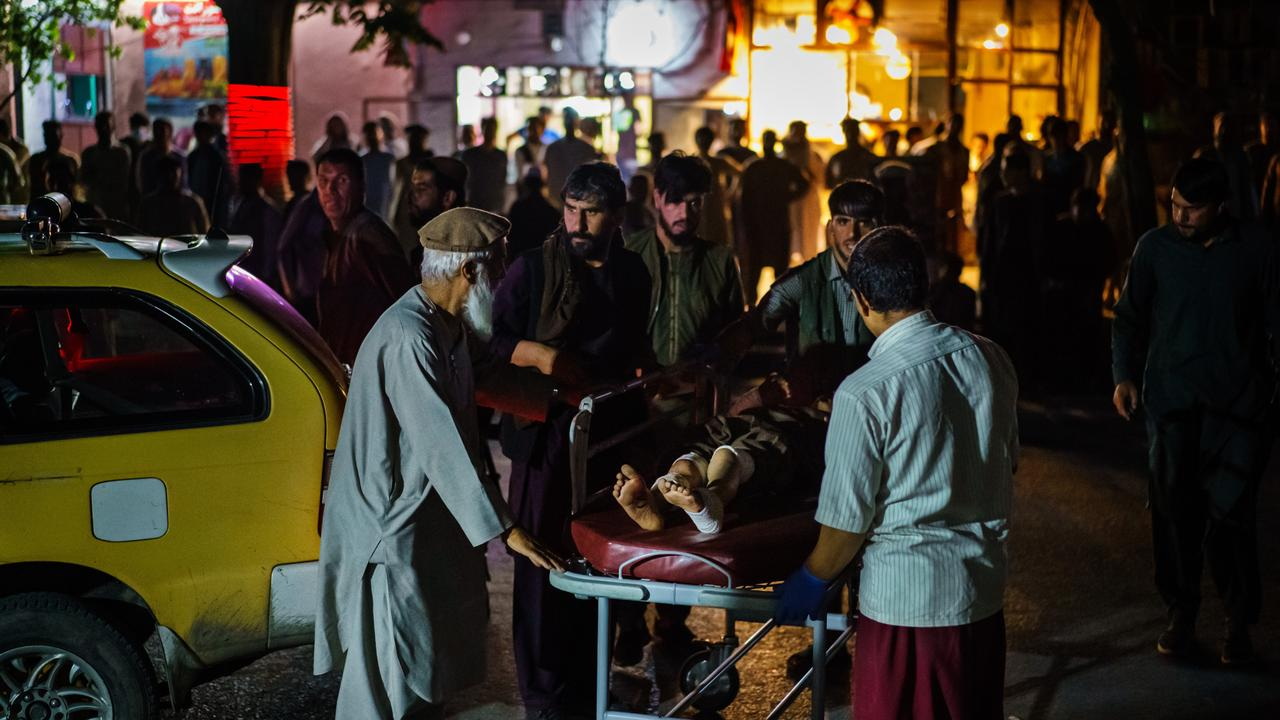 A patient is brought by a taxi to hospital after two bombings struck near the entrance of Kabul airport. Picture: Marcus Yam/Los Angeles Times