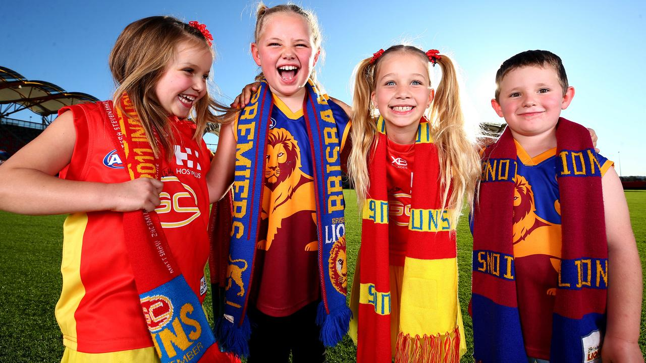 AFL fans Matilda, 5, Amelia, 7, Bronte, 7 and Harley, 5, will get plenty of footy to watch with all the Melbourne clubs in Qld as well as having their own clubs the Suns and Lions at home all the time. Picture: Adam Head