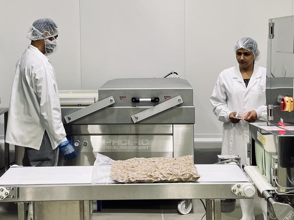 Workers at the Proform Foods facility.