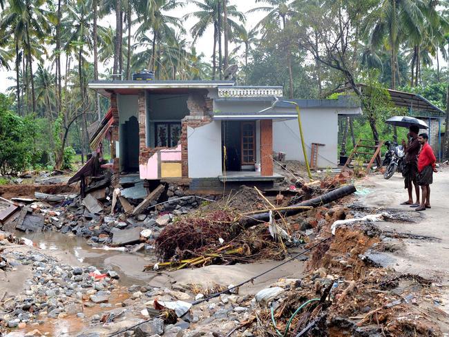 Houses destroyed by a landslide in Kerala, South India, after devastating floods that have killed more than 300. Picture: Manjunath Kiran /AFP