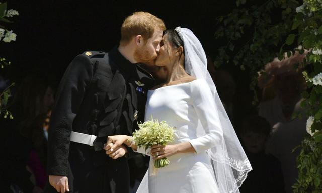 FILE - In this file photo dated Saturday, May 19, 2018, Britain's Prince Harry and Meghan Markle leave after their wedding ceremony at St. George's Chapel in Windsor Castle, in Windsor, England. (Ben Birchhall/pool via AP, FILE)