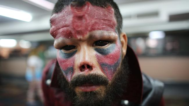 Finished product ... Red Skull poses for a portrait during the annual Venezuela Tattoo International Expo in Caracas, Venezuela last week.