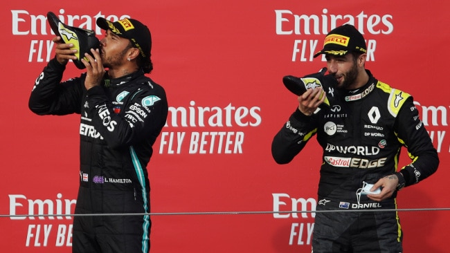 Lewis Hamilton joins Daniel Ricciardo for a toast.