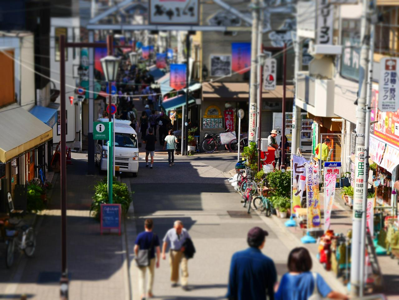 Tokyo, Japan - October 20, 2016:View of Yanaka Ginza street in Yanasen area from yuyake dandan slope. Many tourists come here to enjoy the atomosphere of downtown in Tokyo.
