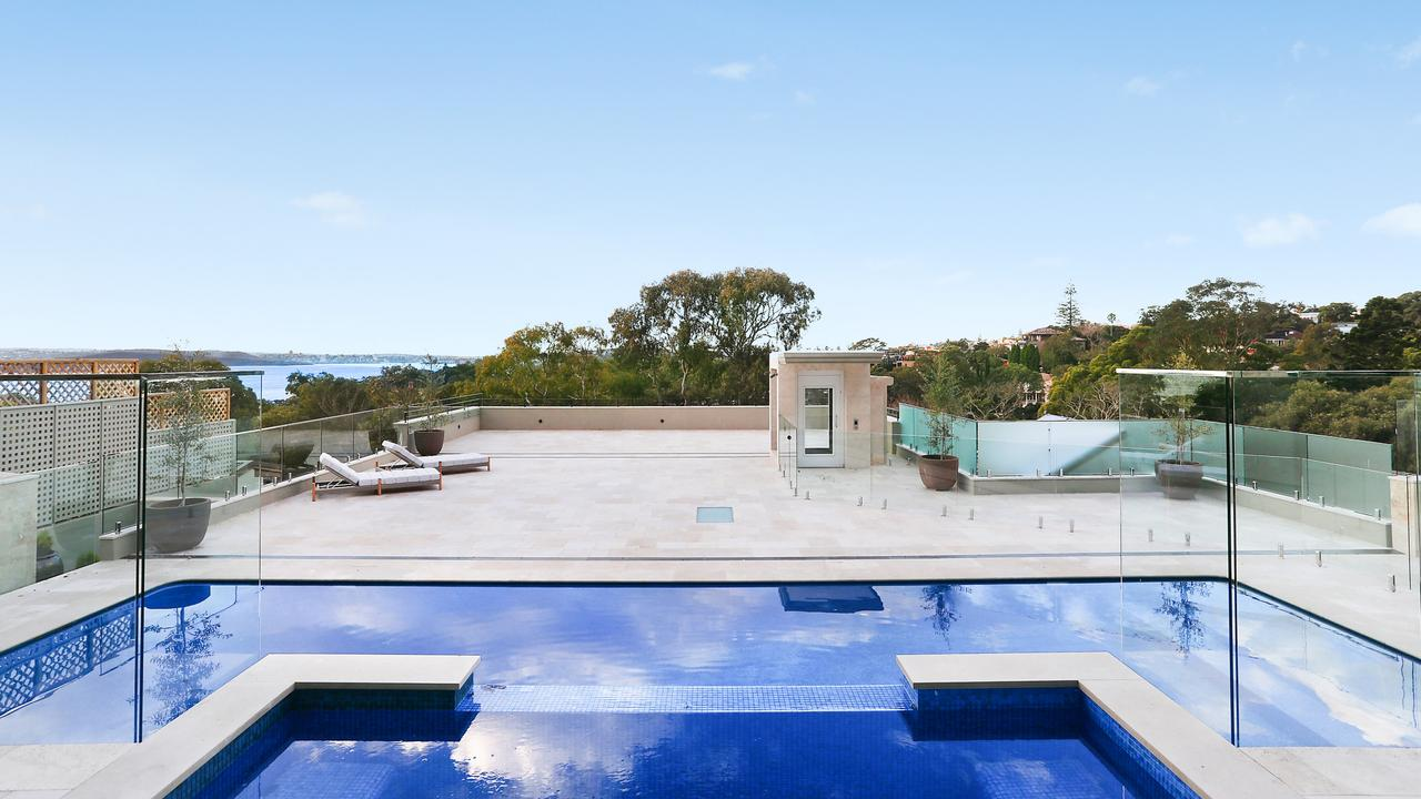 There's lift access to the rooftop with pool, spa and amazing harbour views.