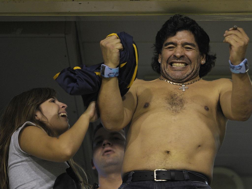 Argentine former footballer Diego Maradona (R) celebrates with his daughter Dalma in 2008.