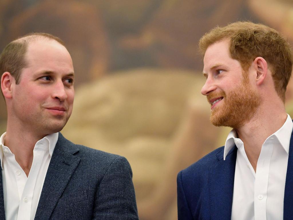 Britain's Prince Harry (R) and Britain's Prince William, Duke of Cambridge.