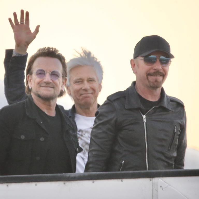 Bono, Adam Clayton and The Edge of U2 arrive in Brisbane yesterday. Picture: Nathan Richter/BackGrid