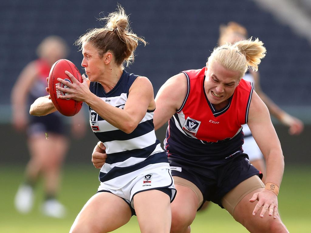Hannah Mouncey tackles an opponent while playing in Victoria. (Photo by Kelly Defina/AFL Media/Getty Images)