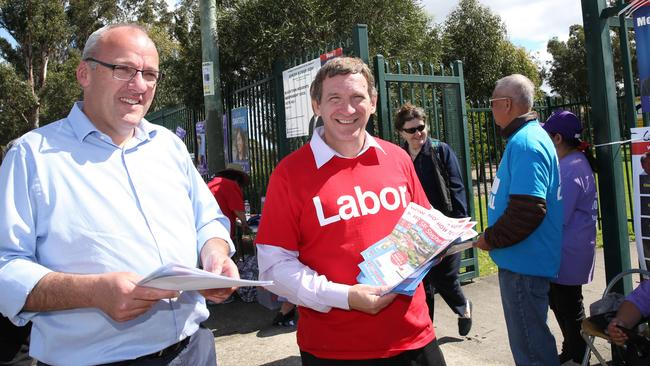 Labour Opposition Leader Luke Foley hands out how to vote cards on Saturday with Blacktown Mayor Stephen Bali.