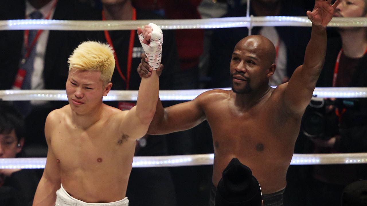 Floyd Mayweather Jr., right, holds the hand of Japanese kickboxer Tenshin Nasukawa, after beating him in their three-round exhibition match on New Year's Eve, at Saitama Super Arena in Saitama, north of Tokyo, Monday, Dec. 31, 2018. (AP Photo/Koji Sasahara)