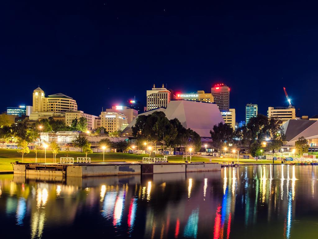 Adelaide: Adelaide city skyline at dusk viewed across Torrens river from King William bridge