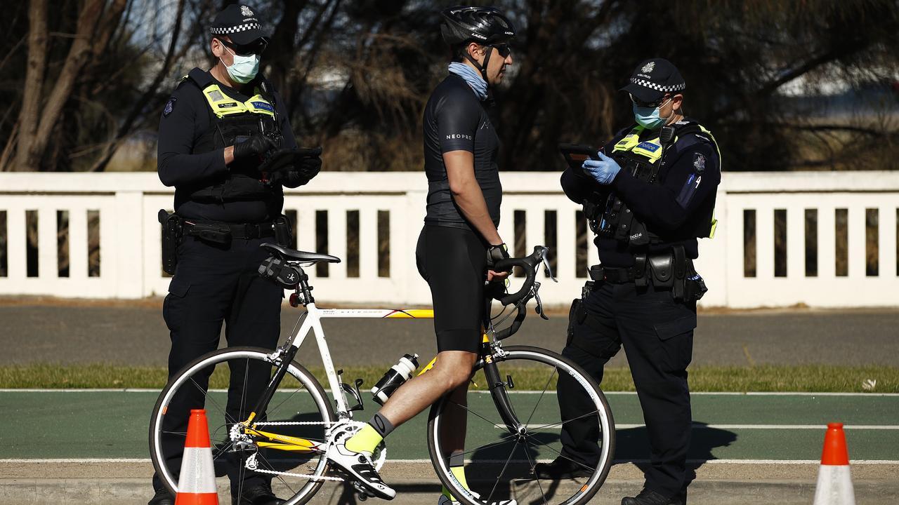 Police check licenses of cyclists along St Kilda Beach in Melbourne, Victoria. Picture: NCA NewsWire / Daniel Pockett