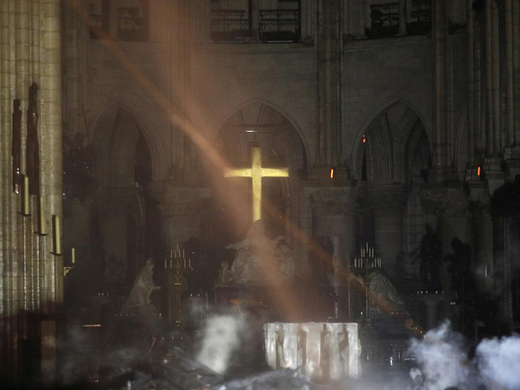 Rubble smoulders inside the Notre Dame Cathedral. Picture: Philippe Wojazer / Pool / AP
