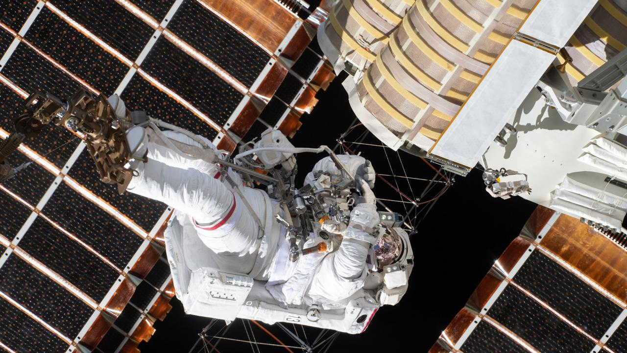 Expedition 65 Flight Engineer Thomas Pesquet of ESA (European Space Agency) is pictured attached to an articulating portable foot restraint on the end of a robotic arm during the space walk to install new solar panels on the International Space Station. Picture: NASA.