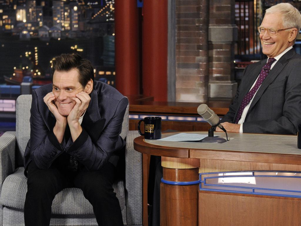 Carrey shares a laugh with Dave Letterman on the Late Show.