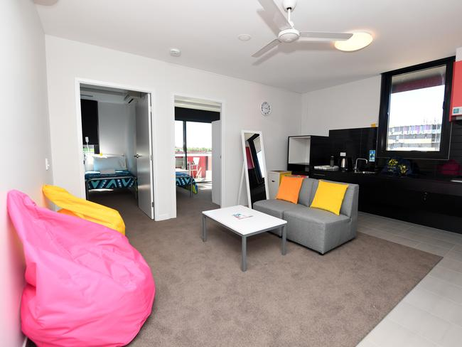 The living room and kitchen area of athletes accomodation is seen during a media tour