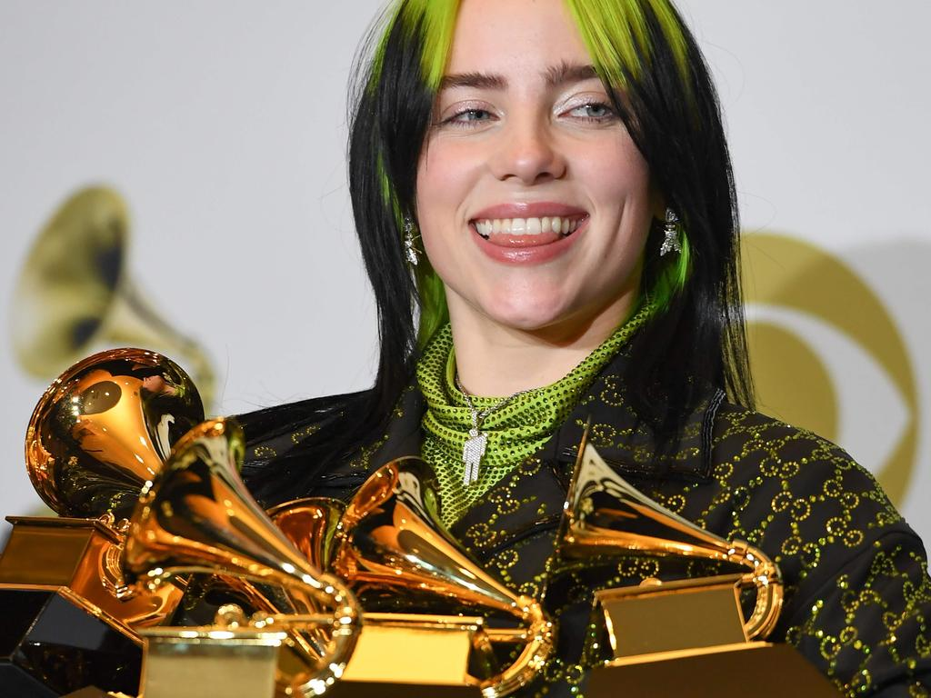 US singer-songwriter Billie Eilish poses in the press room with the awards for Album Of The Year, Record Of The Year, Best New Artist, Song Of The Year and Best Pop Vocal Album during the 62nd Annual Grammy Awards on January 26, 2020, in Los Angeles. (Photo by Robyn Beck / AFP)