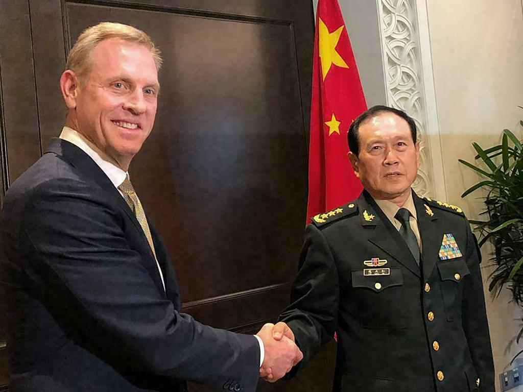 Acting US Secretary of Defense Patrick Shanahan, left, shakes hands with Chinese Minister of National Defense Wei Fenghe during a meeting on the sidelines of the 18th International Institute for Strategic Studies (IISS) Shangri-la Dialogue, in Singapore. Picture: AP