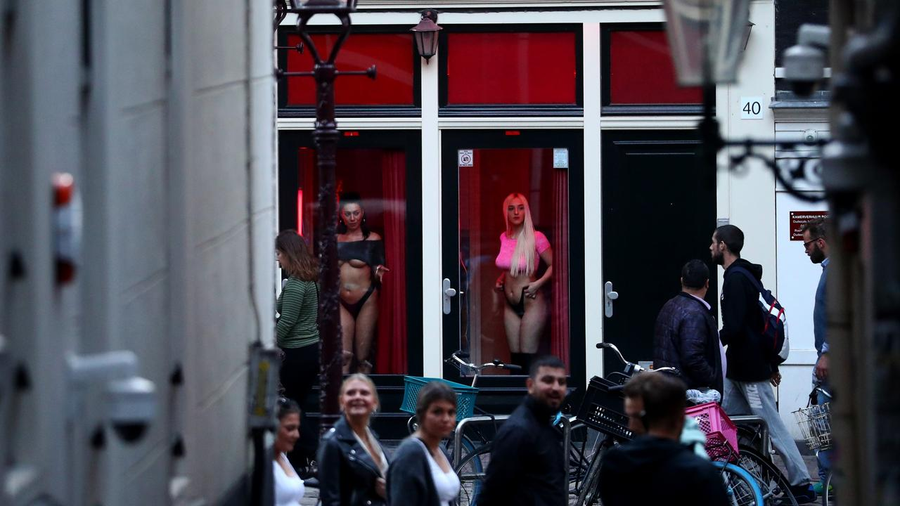"""Brothel windows will be shuttered in the bustling De Wallen neighbourhood and an """"erotic centre"""" will be set up in a yet-to-be-determined areas. Picture: Dean Mouhtaropoulos/Getty Images."""