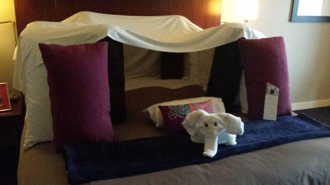 "This request read ""please build a pillow fort on our bed with five (5) additional pillows. We would also appreciate a towel folded into the shape of an elephant. If possible, we would enjoy a sexy picture of some fruit on the night table."" There is no photographic evidence that the ""sexy picture of some fruit"" (?!) was delivered, but boy they nailed the five (5) pillow fort with a bashful elephant guarding the entrance. Picture: Imgur"