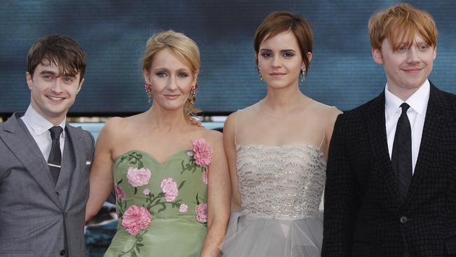 British author JK Rowling, second left, joins actors, left to right, Daniel Radcliffe, Emma Watson and Rupert Grint in Trafalgar Square, central London, for the World Premiere of 'Harry Potter and the Deathly Hallows: Part 2' the last film in the series, Thursday, July 7, 2011. Harry Potter's saga is ending, but his magic spell remains. Thousands of fans from around the world massed in London Thursday for the premiere of the final film in the magical adventure series. (AP Photo/Joel Ryan)
