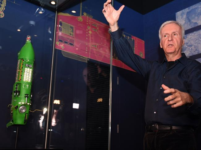 Deep-sea explorer and Academy Award-winning filmmaker James Cameron talks next to a scale model of a deep-sea submarine he used to dive to the bottom of the ocean. Picture: Saeed Khan