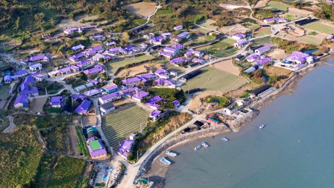 South Korea's Banwol Island is reveling in a massive tourism boom after receiving an epic makeover, with hundreds of buildings and other structures and attractions on the small island painted purple.