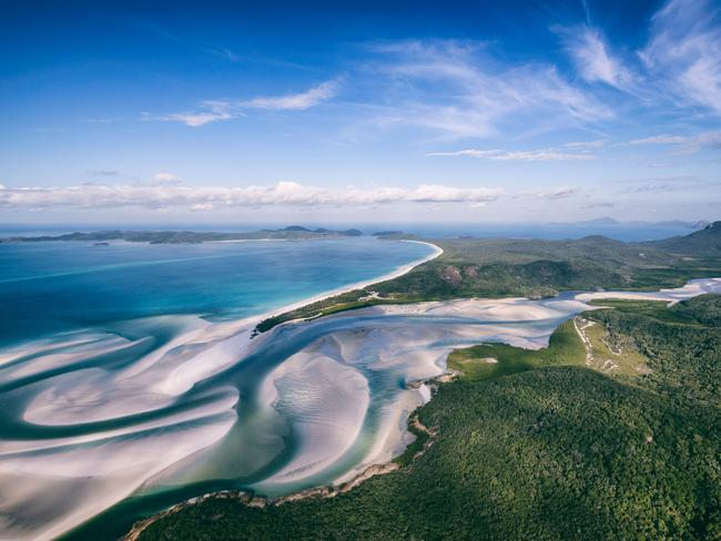 HILL INLET, WHITEHAVEN BEACH As the tide shifts, the white sand and blue hues of the Hill Inlet on Whitsunday Island blend seamlessly to create a breathtaking mosaic. The Inlet is best viewed from the lookout at Tongue Point on the island. Tip: to fully experience the beautiful fusion of colours try to reach the lookout when the tide is low. Picture: Tourism and Events Queensland/Matt Glastonbury