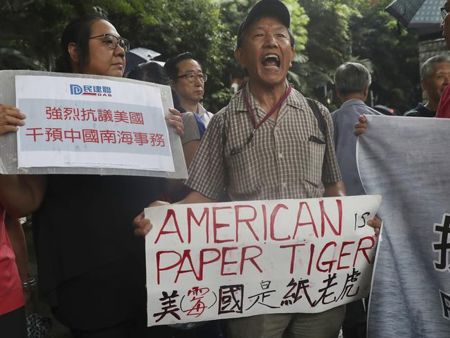 Pro-Beijing protesters shout slogans against the United States supporting an international court ruling of the South China Sea outside the U.S. Consulate in Hong Kong. Picture: Kin Cheung