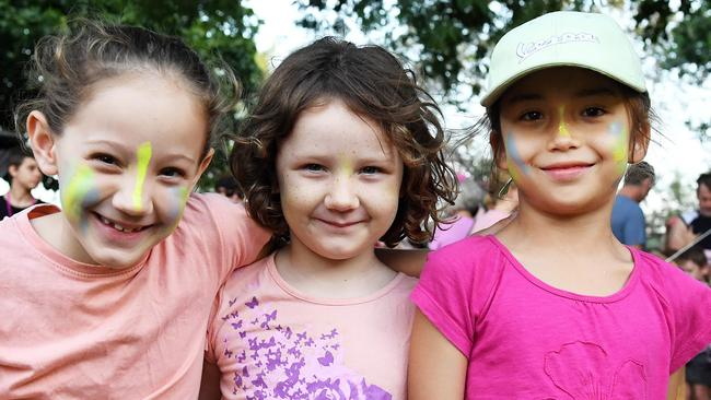 Friends Caitlin Boulton, 7, and Isabelle Boulton, 5 with Niluh Jackson, 6, pose for a quick photo during Sunday's annual Mother's Day Classic fun run and walk at Mindil Beach. PICTURE: Justin Kennedy