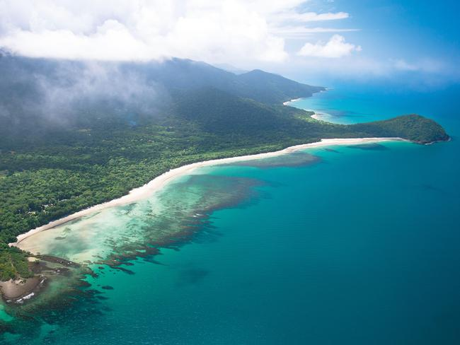 CAPE TRIBULATION Nowhere else in the world will you find a spot where two UNESCO World Heritage sites meet. The Wet Tropics Rainforest and the Great Barrier Reef meet in an array of colour where the greenery of the rainforest and vibrant blues are only separated by a small strip of white sandy beach. Picture: Tourism and Events Queensland/Vince Sofia