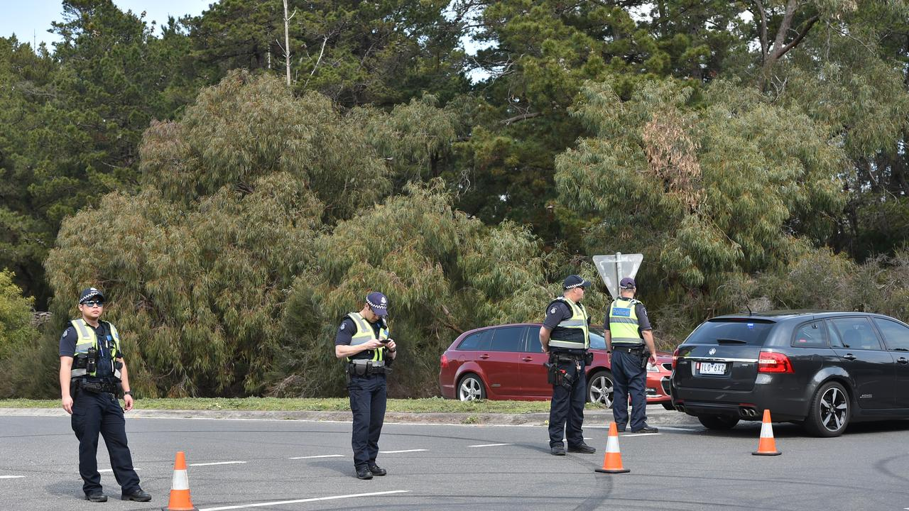 Police had Warneet Rd, Blind Bight, blocked to anyone entering or leaving the suburb. Picture: Jason Edwards
