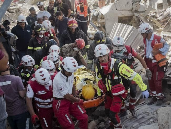 A survivor is pulled out of the rubble in Amatrice. Picture: AP/Emilio Fraile
