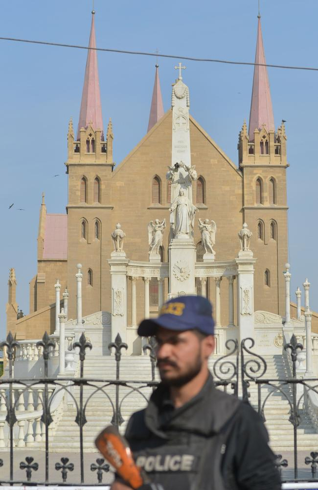 A Pakistani policeman stands guard outside the church suicide bombers attacked overnight. Picture: AFP/Banaras Khan