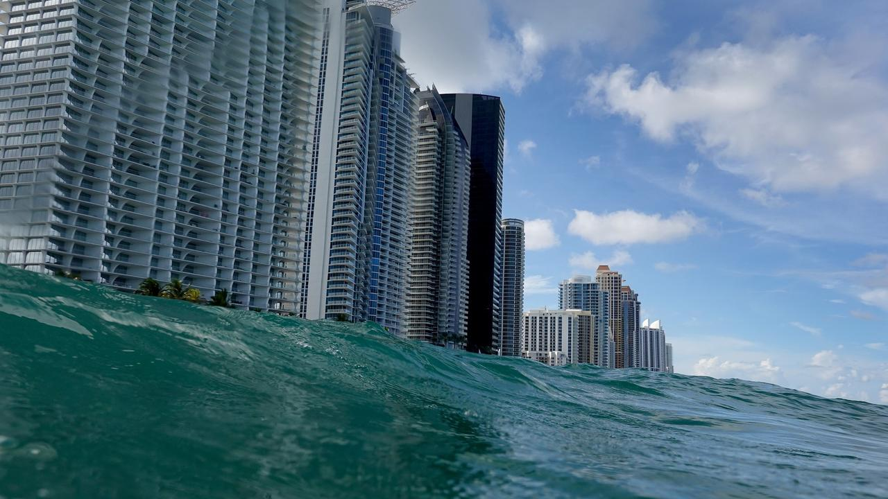 Waves lap ashore near condo buildings in the Florida city of Sunny Isles. Picture: Joe Raedle/Getty Images/AFP