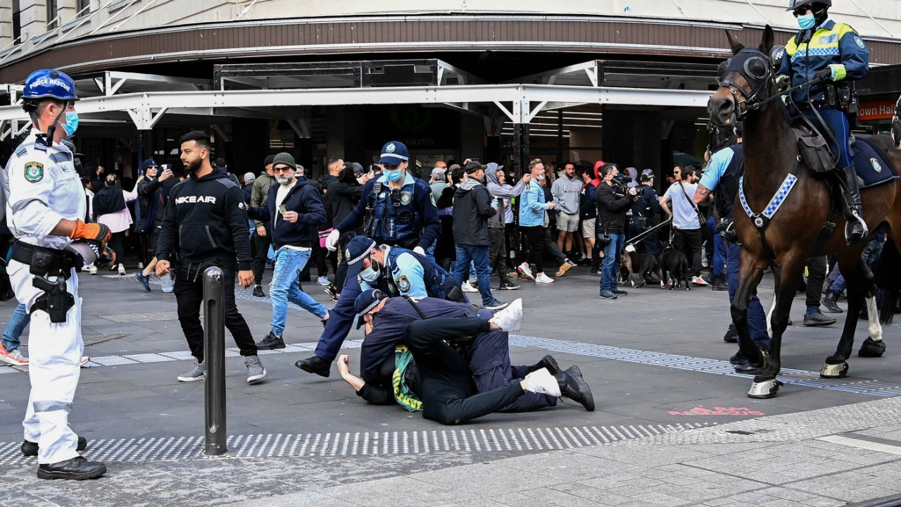 SYDNEY, AUSTRALIA - NewsWire Photos - JULY, 24, 2021: Protestors clash with NSW Police officers at Town Hall during a protest to rally for freedom of speech, movement, choice, assembly, and Health in Sydney. Picture: NCA NewsWire/Bianca De Marchi