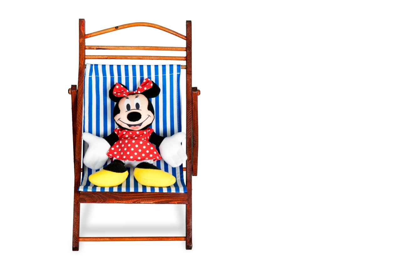 "Cinnaminson, New Jersey, USA - May 28, 2011: Minnie Mouse on a Beach Chair. Mickey. Minerva ""Minnie"" Mouse is an animated character created by Ub Iwerks and Walt Disney. The comic strip story ""The Gleam"" (published January 19-May 2, 1942)"
