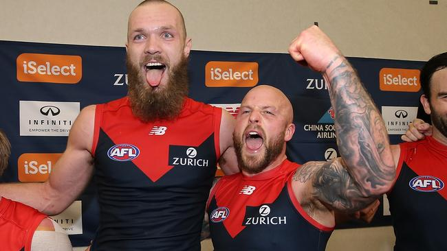 Nathan Jones sings the song with Max Gawn after the win. Picture: Getty