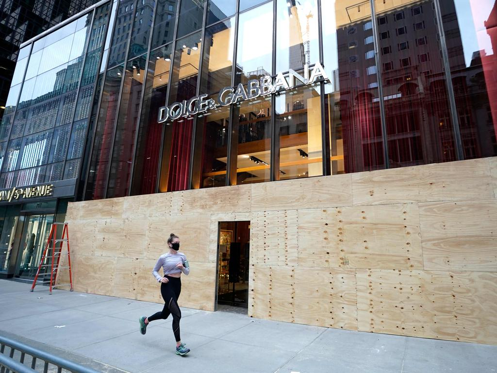 The grand entrance to Dolce & Gabbana is now a door in the plywood. Picture: Timothy A. Clary/AFP