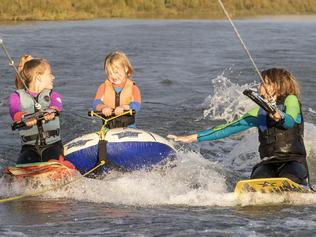 Reef Fahey, 12, is planning on skiing 213kms to raise awareness for T21 (down syndrome) and Ski for Life. Reef with his Sister Mahala, 10 and little brother Koa, 5 who suffers from down syndrome at Murray Bridge, 6 May 2021. Picture Simon Cross